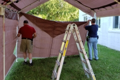 Jeff-and-Marting-assembling-dining-tent