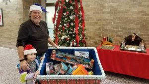 Richm N2WJL and grand-daughter bring toys to NUMC.